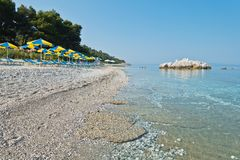Sea rocks at calm and crystal clear turquoise water at morning, Milia beach, island of Skopelos royalty free stock image