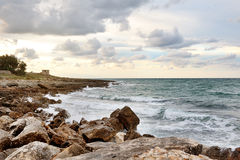 Sea on the rocks in a cloudy day, Ostuni, Apulia, Italy Stock Image