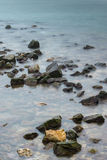 Sea rocks. A foggy morning on the shore of Black Sea, near Constanta, Romania Stock Image