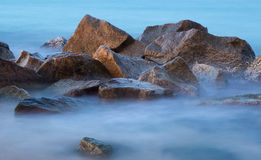 Sea rocks in mist at dusk Royalty Free Stock Images