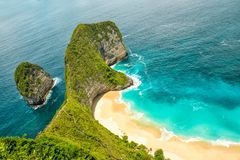 Sea rocks sand beach turquoise ocean Nusa Penida Island Bali royalty free stock image