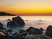 Sea rocks at sunrise. Rocks at the coast just before sunrise Royalty Free Stock Photography