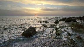 Sea rocks at sunrise stock video footage