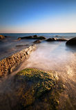 Sea rocks at the sunset Stock Photography