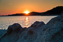Sea rocks at sunset, west coast of peninsula Sithonia, Chalkidiki Royalty Free Stock Photo