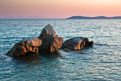 Sea rocks at sunset, west coast of peninsula Sithonia, Chalkidiki Stock Photos