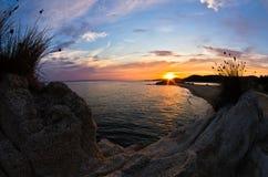 Sea rocks at sunset, west coast of Sithonia, Chalkidiki Royalty Free Stock Image