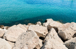 Sea rocks and the surface of sea water Royalty Free Stock Photo