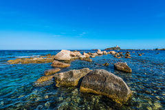 Sea Rocks and Tower in Nora near Pula, Sardegna Stock Photos