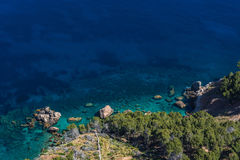 Sea rocks and transparent sea. Sea waves and rocks on the steep west coast of Mallorca Royalty Free Stock Images