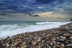 Sea, rocks and waves. The sea and the waves, an evening landscape Royalty Free Stock Photography