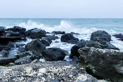 Sea and rocks. Sea waves over black rocks Royalty Free Stock Images