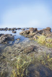 Sea and rocky coast in the morning Stock Photos