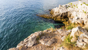 The sea and the rocky steep coast of the Mediterranean Sea. Stock Images