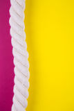 Sea rope on colored backgrounds with negative space. Summer back. Sea rope on colored yellow and crimson backgrounds with negative space. Minimalistic colorful Royalty Free Stock Image