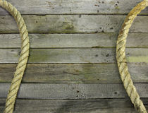 Sea rope frame on wood Stock Photos