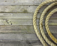 Sea rope rolls on wood Stock Photos