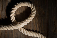 Sea rope on a wooden background. Stock Photos
