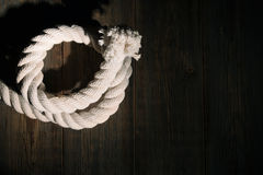 Sea rope on a wooden background. Stock Photography