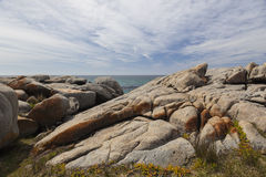 Sea and rough rocks at Bingie Point. Australia. Royalty Free Stock Photo