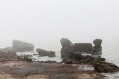 Sea and ruined fors. Latvia The ruined forts of the Carport stand in a baffling mist Royalty Free Stock Photo