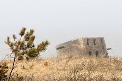 Sea and ruined fors. Latvia The ruined forts of the Carport stand in a baffling mist Stock Photo