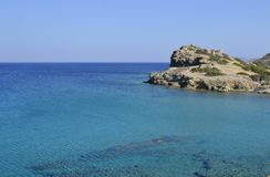Sea and ruins in Crete, Greece. Everywhere in Crete (Greece) you can find ancient ruins and beautiful sea for an unforgettable swim. This shot has been taken Royalty Free Stock Image