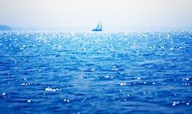 Sea, sailboat on the horizon Stock Image