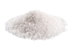 Sea salt. Heap of sea salt isolated on white Royalty Free Stock Image