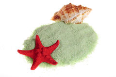 Sea salt. Bath anti-cellulitis spa green sea salt isolated with shell and starfish on white background stock photo
