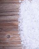 Sea salt. On vintage wooden surface Stock Photos