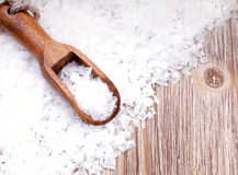 Sea salt. With wooden scoop on vintage  surface Royalty Free Stock Photos
