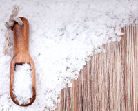 Sea salt. With wooden scoop on vintage  surface Stock Images