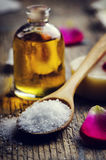Sea salt and aromatic oil Stock Photos