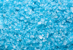 Sea salt background or texture in blue color. Little minerals Royalty Free Stock Photo