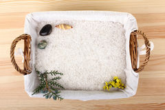 Sea salt in the basket. Sea salt on the spacing with the elements of nature and note-book on wooden background Stock Image