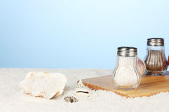 Sea salt on the beach and on the cutting board Stock Image