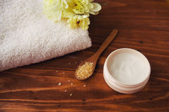 Sea salt  beauty cream with flower and  towels    on  wooden background Stock Image