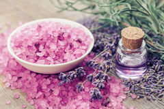 Sea salt, bottle of essential oil and lavender flowers. Royalty Free Stock Images