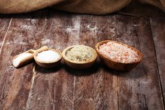 Sea salt in bowl. Crystals of salt on table and himalayan salt. Sea salt in bowl. Crystals of salt on table royalty free stock photos