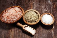Sea salt in bowl. Crystals of salt on table and himalayan salt. Sea salt in bowl. Crystals of salt on table stock images