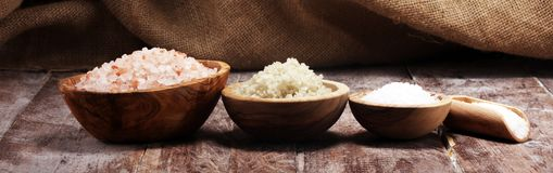 Sea salt in bowl. Crystals of salt on table and himalayan salt. Sea salt in bowl. Crystals of salt on table stock photo
