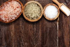 Sea salt in bowl. Crystals of salt on table and himalayan salt. Sea salt in bowl. Crystals of salt on table stock image
