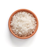 Sea salt in bowl on white background Royalty Free Stock Photography