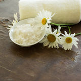 Sea salt in bowl on wooden background Stock Images