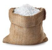 Sea salt in burlap sack isolated on white Royalty Free Stock Photo
