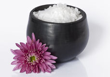 Sea salt in a ceramic bowl with flower Royalty Free Stock Photo