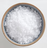 Sea Salt. Coarse sea salt in a bowl on white background Stock Image