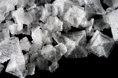 Sea salt crystals flakes on black background Stock Photo
