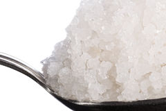 Sea salt crystals large in spoon macro. Royalty Free Stock Photography